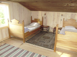 Upper floor bedroom with two beds